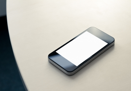 Mobile smartphone lying on the office table with blank screen  photo