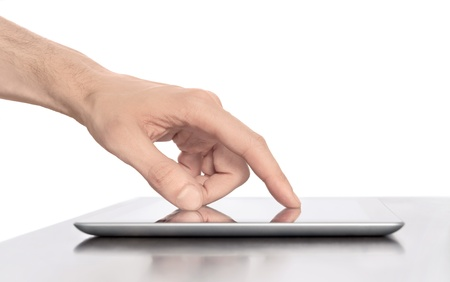 Man hand touching screen on modern digital tablet pc. Close-up image with shallow depth of field focus on finger. Isolated white background. photo