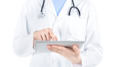 doctors tools: Doctor in white coat with stethoscope holding and touching on digital tablet pc  Isolated on white