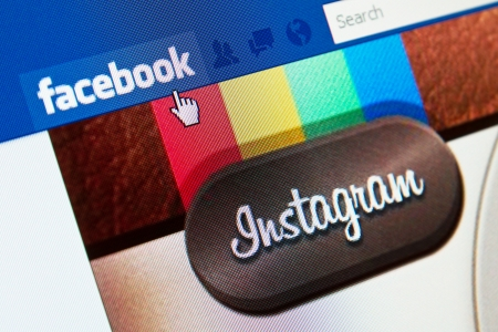 the largest: KIEV, UKRAINE - APRIL 09, 2012: Facebook, the world's largest social network, buys Instagram, the popular mobile photo-sharing service, for $1 billion in cash and stock.