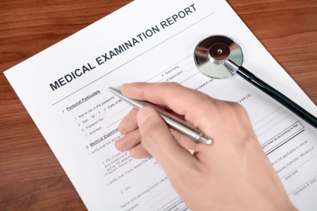 medical emergency service: Doctor fills out blank medical report form