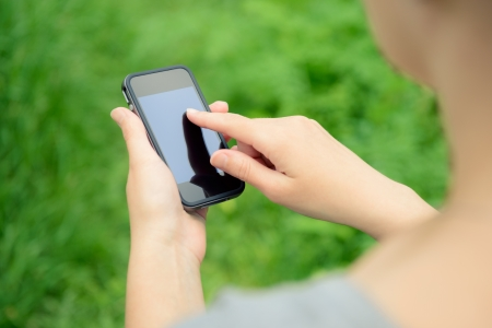 woman on phone: Woman using mobile smart phone in the park
