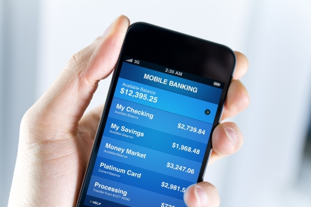 mobile banking: A man holding smartphone with mobile banking application on a screen