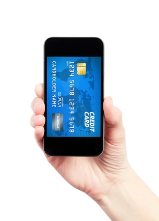 Hand holding mobile smart phone with credit card on a screen  photo