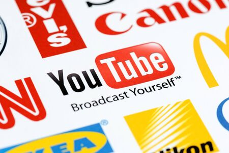 youtube: Kiev, Ukraine - June 27, 2012 - Close up photo of the Youtube logo on the printed paper together with a collection of well-known brands of the world.