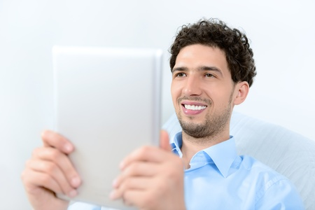 Young handsome man using a modern digital tablet  Studio shot Stock Photo - 14937279