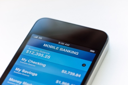 bank: Mobile phone with mobile banking application on a screen  Closeup shot