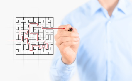 path ways: Young businessman drawing success way to find solution concept  Isolated on white  Stock Photo