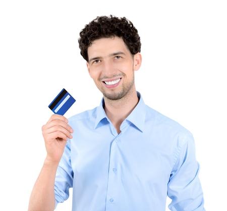 hand business card: Giovane uomo bello che mostra la carta di credito isolato su bianco