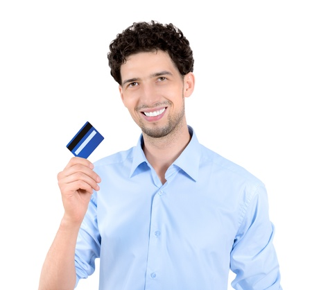 debit card: Young handsome man showing credit card  Isolated on white