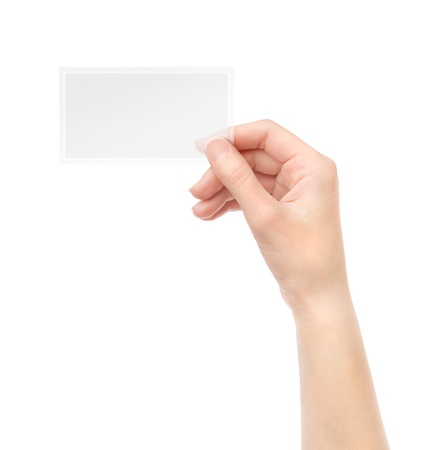 Female hand holding blank transparent business card in hand  Isolated on white  photo