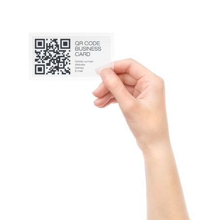 Female hand holding transparent business card with QR code information  Isolated on white  Stock Photo - 15892967
