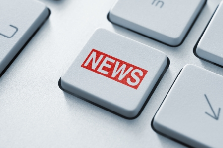 business news: Hot news key button on keyboard  Stock Photo
