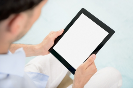book reviews: Man holding blank digital tablet in hands  Stock Photo