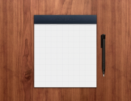 writing pad: Blank notepad with pen on a wooden desk  High quality graphic collage