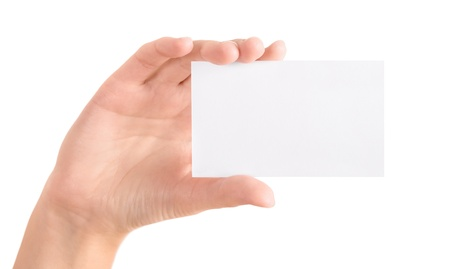 Woman holding blank business card in hand  Isolated on white  photo