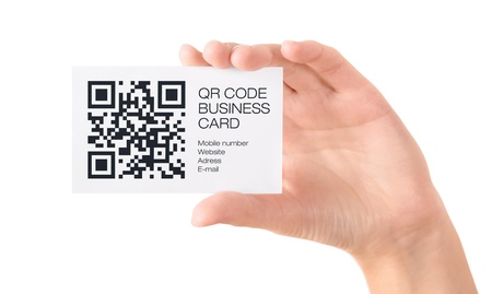 Hand showing business card with QR code information  Isolated on white  photo
