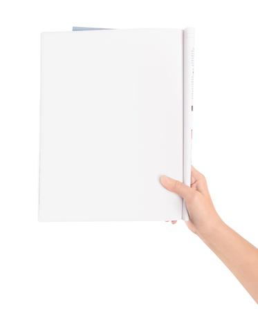 Hand holding magazine with blank page  Isolated on white  photo