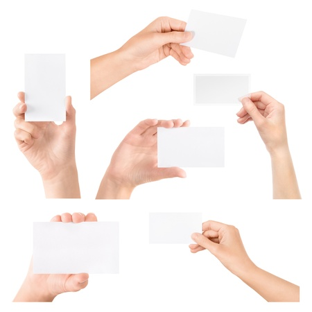 a placard: Female hand holding blank transparent business card in hand  Collection set  Isolated on white  Stock Photo
