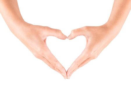 제스처: 흰색에 고립 된 여성의 손을 나타내는 심장 모양의 제스처