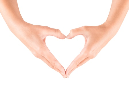 gestos: Mujer que muestra gesto de mano en forma de coraz�n aislado en blanco Foto de archivo