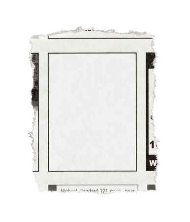 Piece of paper with blank advertisement space torn out from newspaper  Isolated on white  photo
