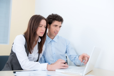 A business team are planning and discuss the project with a modern laptop Stock Photo - 16753582