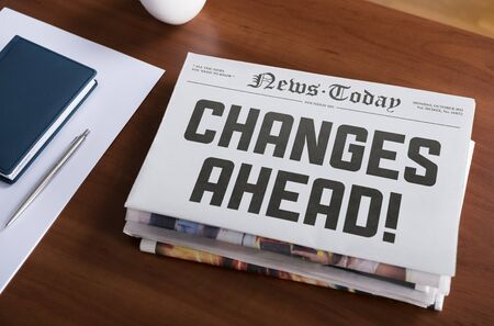 topic: Newspaper with hot topic  Changes Ahead  lying on office desk