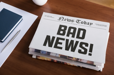 hot news: Newspaper concept with hot topic  Bad news  lying on office desk