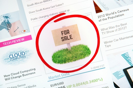 Sign on internet advertising with text FOR SALE and red circle selection around. photo