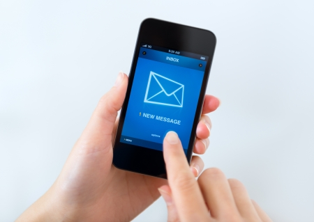 email contact: A new message received on mobile phone. Stock Photo