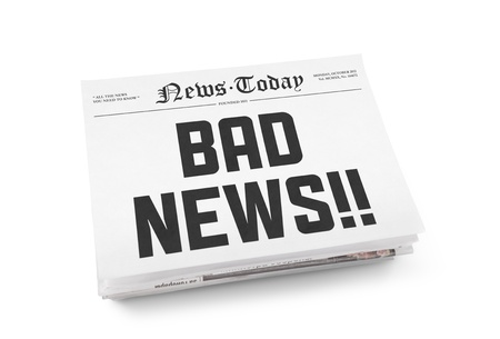 A stack of newspapers with headline  Bad news  on a front page  Isolated on white
