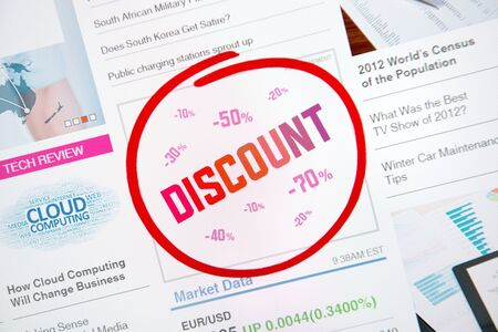 Internet advertisement with text  DISCOUNT  and red selection circle around   photo