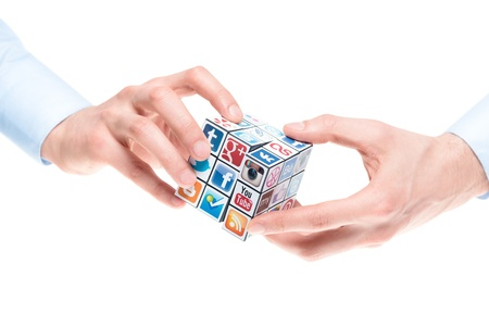Kiev, Ukraine - February 2, 2013: A hands holding rubik cube with logotypes of well-known social media brand