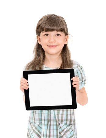 Charming pretty little girl holding up a modern digital tablet in her hands with the blank white screen  Isolated on white  photo