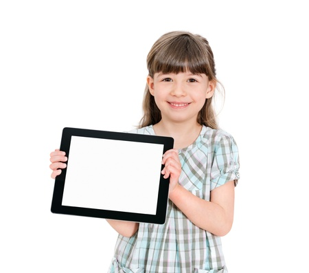 blank screen: Happy attractive little girl holding a blank tablet up in her hands so that the blank screen with white copyspace is displayed towards the camera  Isolated on white