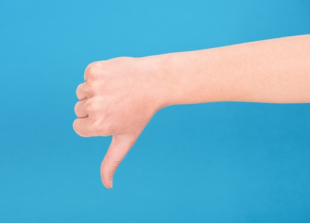 downgrade: Right hand showing thumb down on blue background