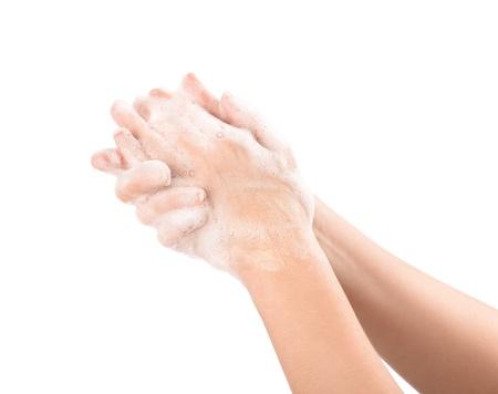 lavamanos: Una mujer se lava las manos con jabón aislado en blanco