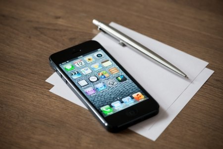 editorial: Kiev, Ukraine - January 18, 2013: The new black Apple iPhone 5, sixth generation version of the iPhone is slimmer and lighter model with new high-resolution, 4-inch screen display.