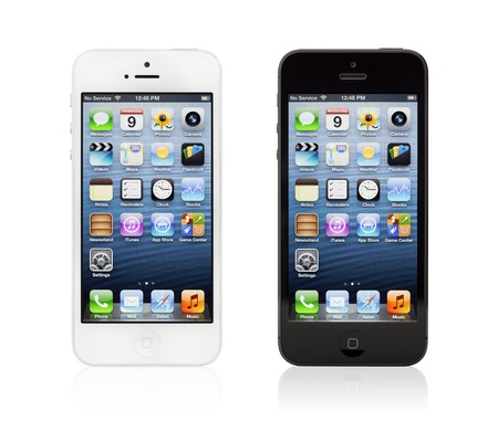 editorial: Kiev, Ukraine - January 9, 2013: The two new black and white Apple iPhone 5, sixth generation version of the iPhone is slimmer and lighter model with new high-resolution, 4-inch screen display.