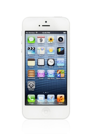 Kiev, Ukraine - January 9, 2013: The new white Apple iPhone 5, sixth generation version of the iPhone is slimmer and lighter model with new high-resolution, 4-inch screen display.
