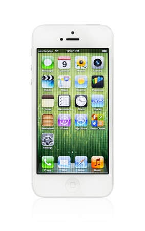 Kiev, Ukraine - January 11, 2013: The new white Apple iPhone 5, sixth generation version of the iPhone is slimmer and lighter model with new high-resolution, 4-inch screen display. Stock Photo - 18831668