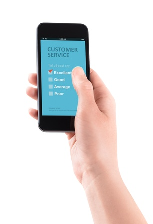 customer survey: Female hand holding modern smartphone with customer service survey form on a screen  Red tick on excellent choice showing customer satisfaction