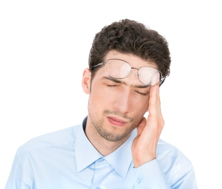 exhausted: Handsome young businessman suffers from a headache  Isolated on white background  Stock Photo