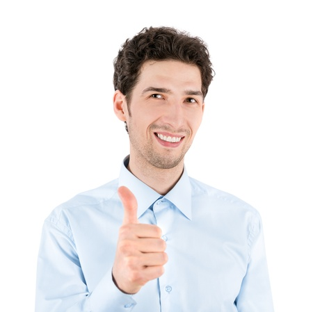 Close-up portrait of a successful handsome businessman who smiles and shows a thumb up gesture to camera  Isolated on white background  photo