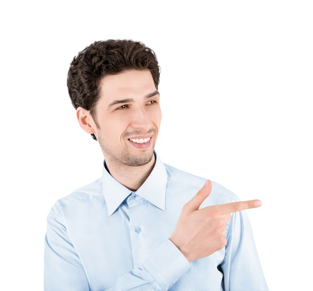 Close-up portrait of a successful handsome businessman, smiling and pointing on the copy space  Isolated on white background photo