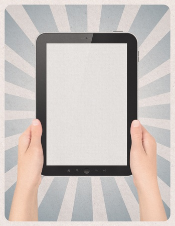 portable information device: Retro style poster or vintage advertisement with modern blank digital tablet in hands and sunbeam stripes on grunge paper background