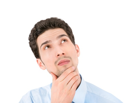 Portrait of a young thoughtful businessman looking up at copyspace  Isolated on white background Stock Photo - 19357137