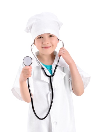 Portrait of a smiling little girl wearing as a nurse on white uniform and holding a stethoscope in hand  Isolated on white background  photo