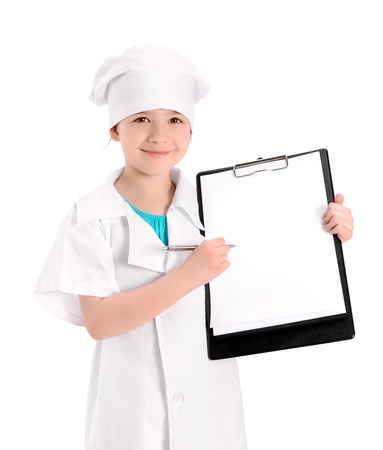 Smiling little girl wearing as a nurse on white uniform pointing with pen on a blank medical report  Isolated on white background  photo